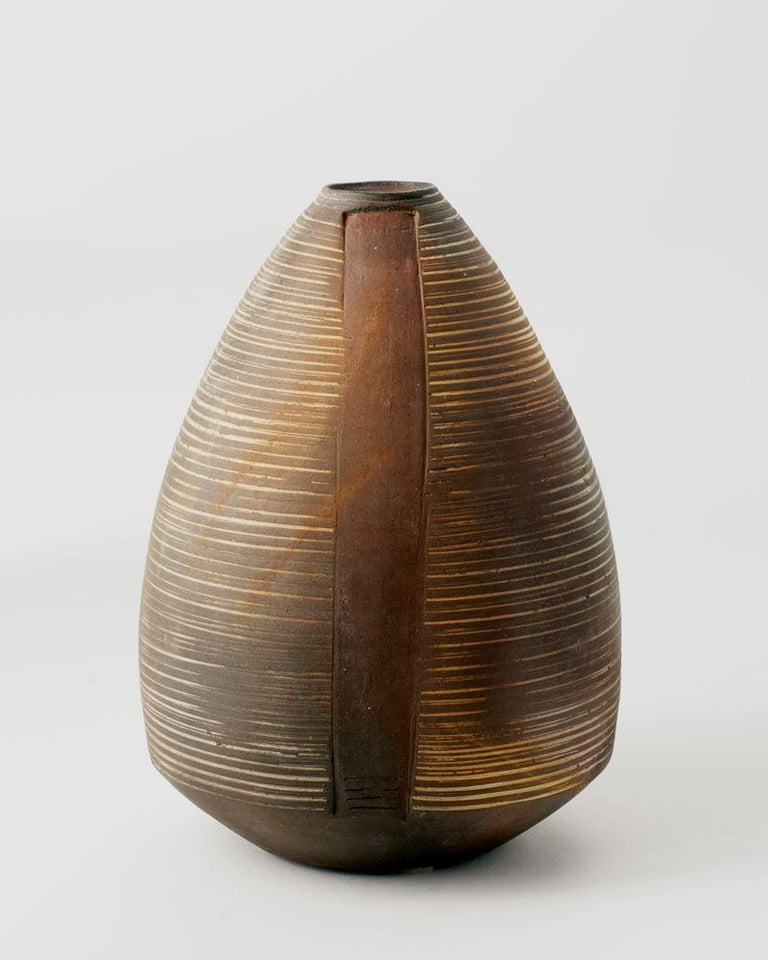 Unique piece Signed: AE  Master ceramicist Eric Astoul created this piece as part of a series inspired by both modern and ancient stoneware, which, with its rough firing, flips the traditional ceramic craft known to La Borne on its head.