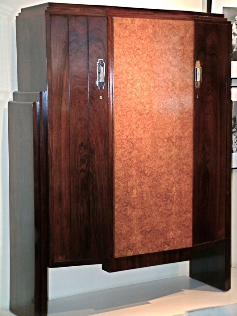 French Modernist Art Deco cabinet by Eric Bagge in Brazilian rosewood and elm, with nickeled bronze lockplates, circa 1930. Measures: 52