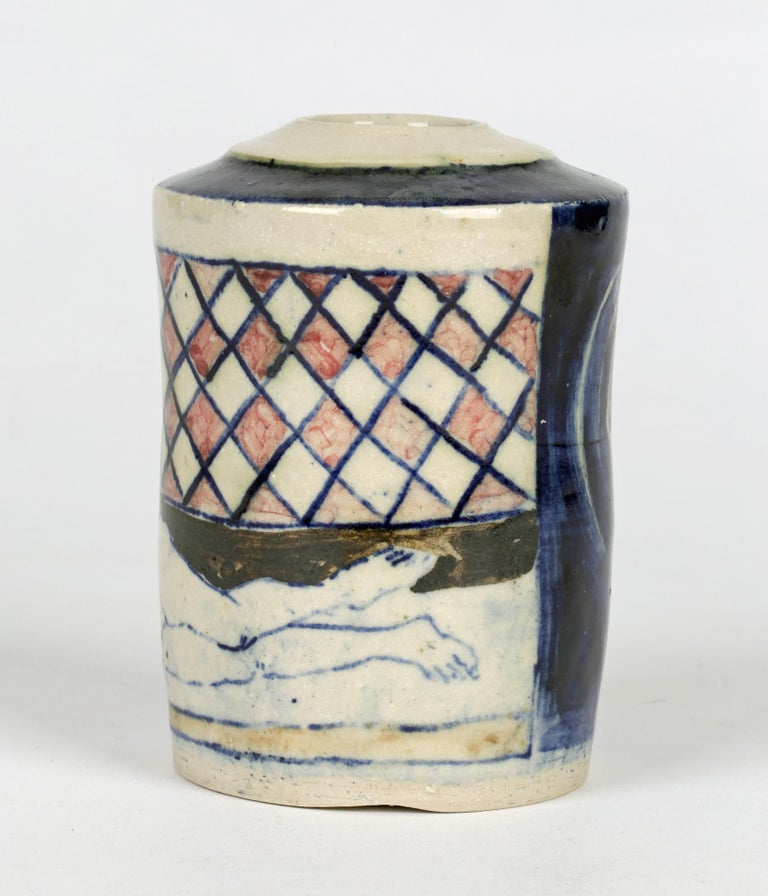 A stylish British studio pottery vase painted with nude figures by renowned potter Eric James Mellon (1925-2014) and dating from around 2000. The vase is of cylindrical shape and potted in porcelain with a slightly domed top with a narrow rounded