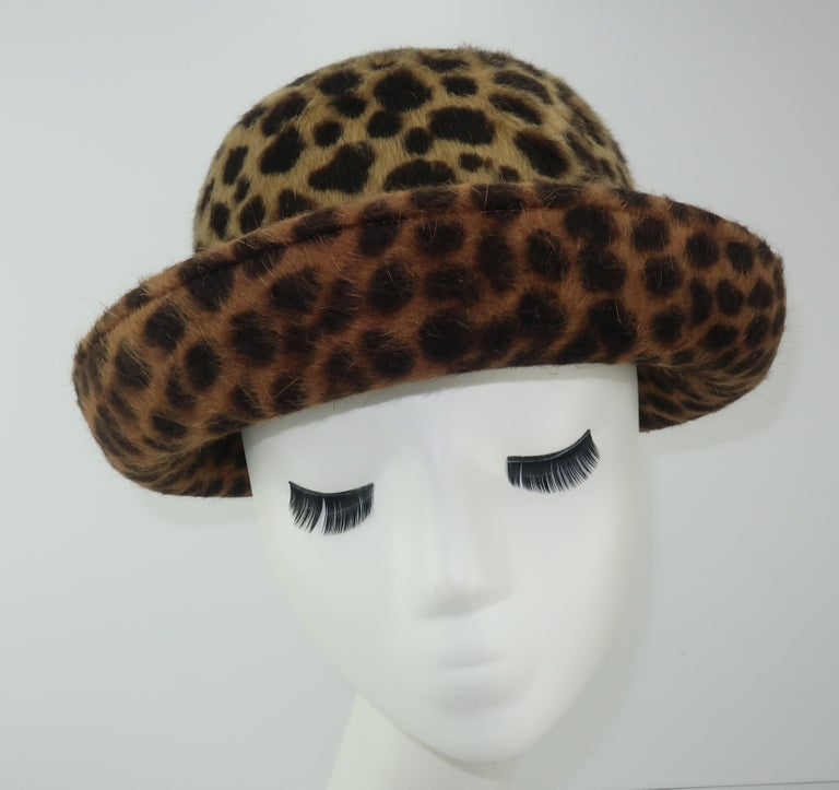 A bowler hat silhouette from Eric Javits with an animal print mohair in shades of dark brown to light camel.  It has a gradient pattern from crown to brim creating a subtle color shift from light to dark framing the face.  Eric Javits toppers are