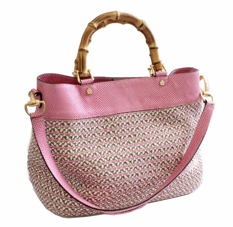 This fabulous bag is from Eric Javits New York.  Called the Analu Squishee Tote, this version features a pink and white weave, with pink lizard stamped leather trim.  In very good preowned condition with minimal signs of prior wear.  Dimensions: