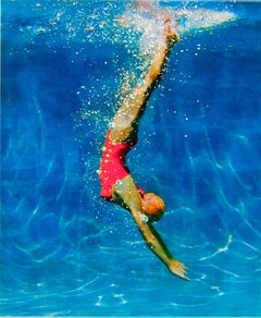 FROM ONE PLACE TO ANOTHER, women in red bathing suit, diving, hyper-realism