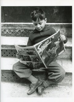 Italy 1956 - Boy reading a newspaper