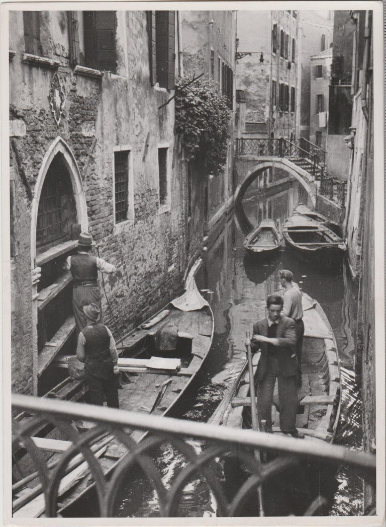 Erich Andres Black and White Photograph - Venice - Gondoliers in a hidden channel