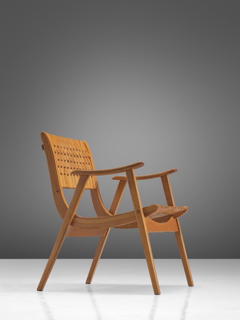 Erich Diekmann for Gelenka Tyskland, bent beech plywood, Germany, circa 1930.  This chair is designed by the German designer Erich Dieckmann who was affiliated to Bauhaus. The chair is executed with typical bent plywood and a webbed back. The
