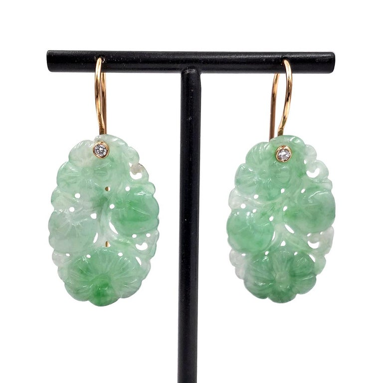 One of a Kind Earrings handcrafted in Germany by renowned master metalsmith Erich Zimmermann, featuring an exquisite 24.79 total carat matched pair of carved light green jadeite. The stunning gemstones dangle beautifully from handmade 18k rose gold