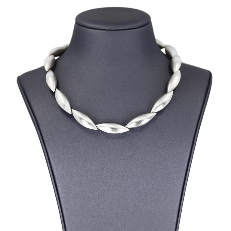 Cocoon Necklace handcrafted in Germany by acclaimed master metalsmith and jewelry maker Erich Zimmermann in signature, fine silver-brushed sterling silver, featuring fifteen hand-fabricated cocoon elements that interconnect to one another invisibly