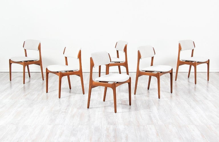 Set of six modern dining chairs Model 49 designed by Erik Buch for Oddense Maskinsnedkeri in Denmark, circa 1960s. This exceptional set features a solid teak construction with new beige tweed upholstery for a comfortable seating experience. The