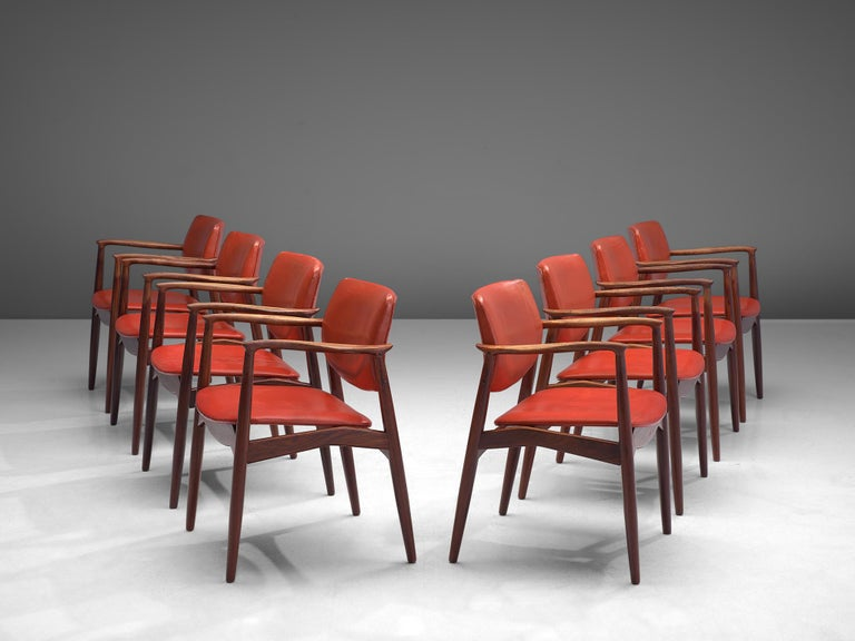Erik Buch, set of eight dining chairs model 50, rosewood and red leather, Denmark, 1960s.  These solidly constructed rosewood chairs show elegant lines and stunning wood connections. This set of six, best known as 'model 50', shows the Danish
