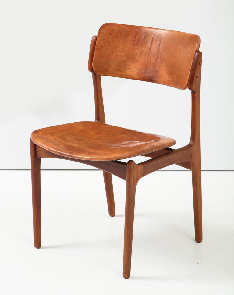 Model 49 chair by Danish designer Erik Buck, made by the Poul Dinesen cabinet shop, circa 1950s. An early example of this classic design, with great character and patina, pre-dating the mass production run by Oddense. With pegged butt joints,