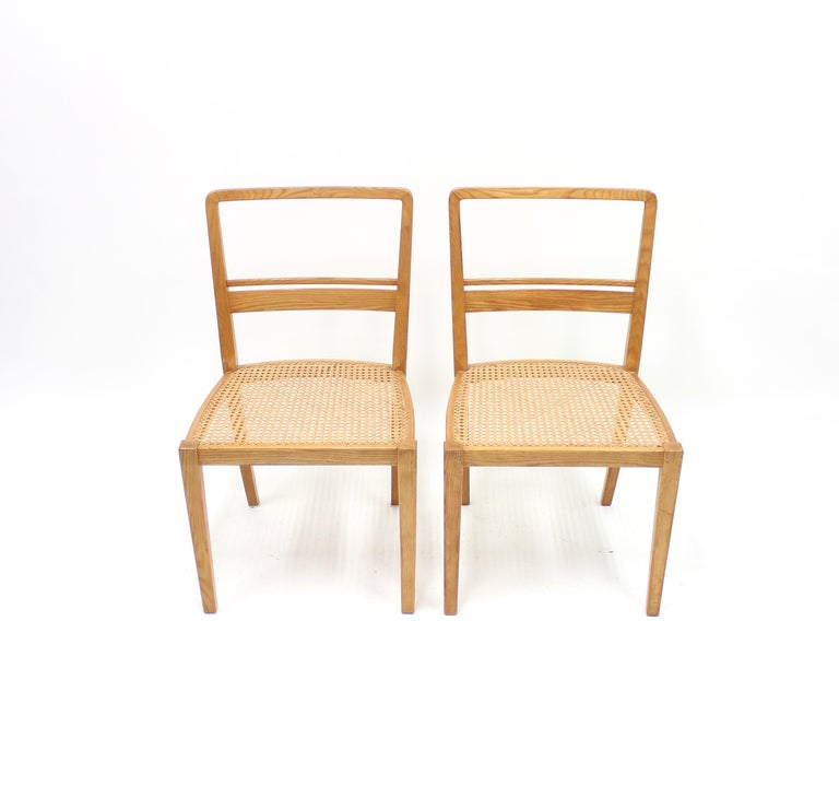 Very rare pair of chairs designed by Erik Chambert in 1937 and produced by his own company AB Chamberts Möbelfabrik. Frame made of ash with cane seat. This exact model was displayed in the International World Exhibition in Paris in 1937 and were