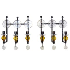 Erik Höglund for Kosta Boda, a Pair of 3-Armed Wall Candleholders in Cast Iron
