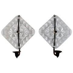 Erik Höglund for Kosta Boda, Two Wall Candleholders in Clear Art Glass and Iron