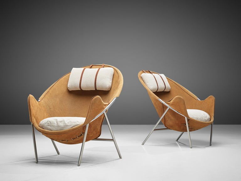 Erik Jørgensen, pair of lounge chairs, metal, suede, fabric, wood, Denmark, design 1953  This set of two easy chairs is executed in cognac suede. These sling chairs consist of a chromed tubular frame in a round shape. To increase the comfort,