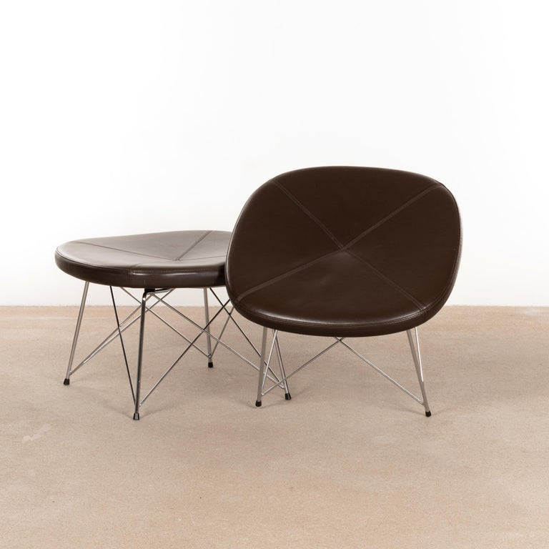 Functional stool / ottoman (Model EJ 141) designed by Anne Mette Jensen & Morten Ernst for Erik Jørgensen, Denmark. Chrome-plated rod steel bases with dark brown leather seats. Good original condition with normal and light traces of use.