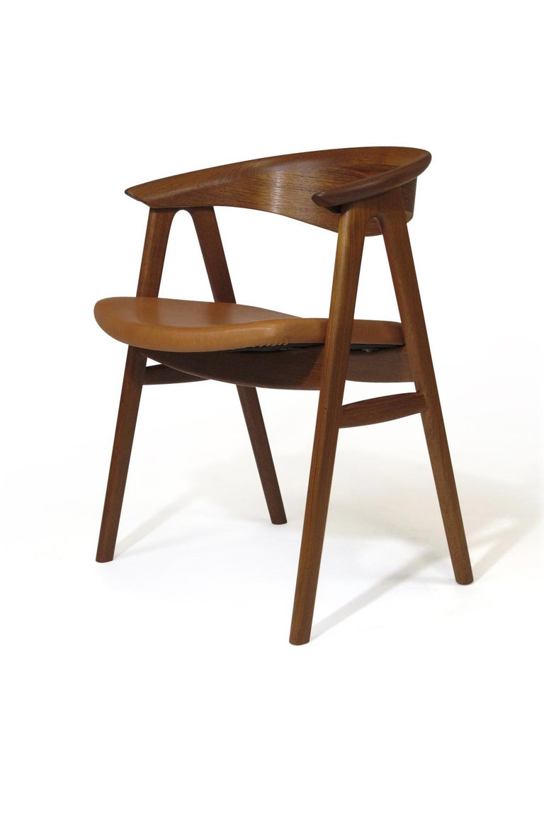 Danish midcentury teak dining chairs designed by Erik Kirkegaard, model 52, crafted of teak with sculpted backrest on a sold teak frame with newly upholstered in saddle leather. Fully restored and in an excellent condition with minor signs of age