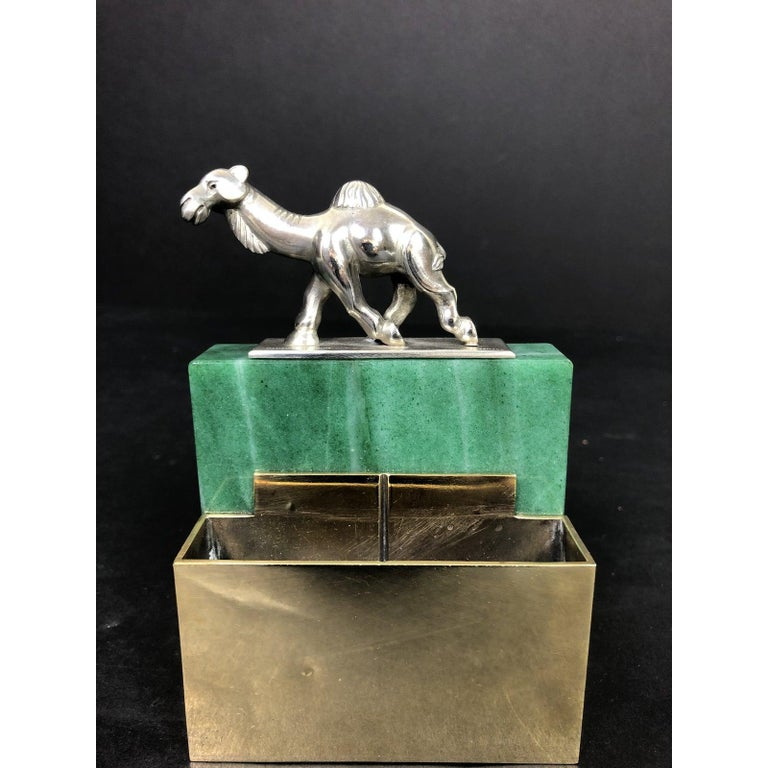 Erik Magnussen (1884-1961) a week known Danish designer-silversmith. This unique item is sterling silver, bronze and aventurine. A beautiful and creative use of materials. A stylized camel marked sterling sits at top of this interesting piece.