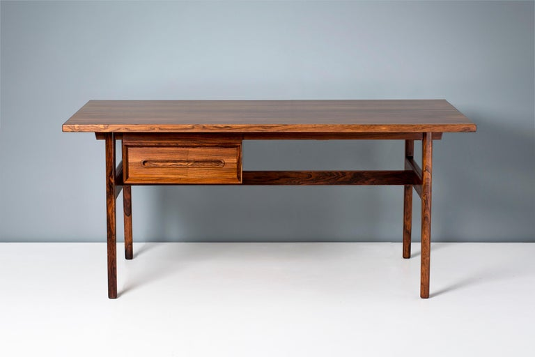 This rarely seen desk from the prolific but lesser known Danish designer Erik Wørts is made from highly figured Brazilian rosewood. It was produced by Henrik Wørts Møbelsnedkeri in Denmark circa 1957 and features a 2-drawer unit under the desk apron