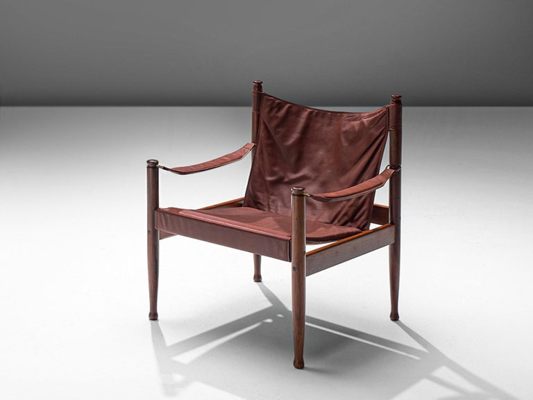 Erik Wørts for Niels Eilsersen, armchair, oak and leather, Denmark, 1960s, later production.  This sturdy lounge chair with refined details is designed by Danish designer Erik Wørts. The safari easy chair has a strong expression due to the