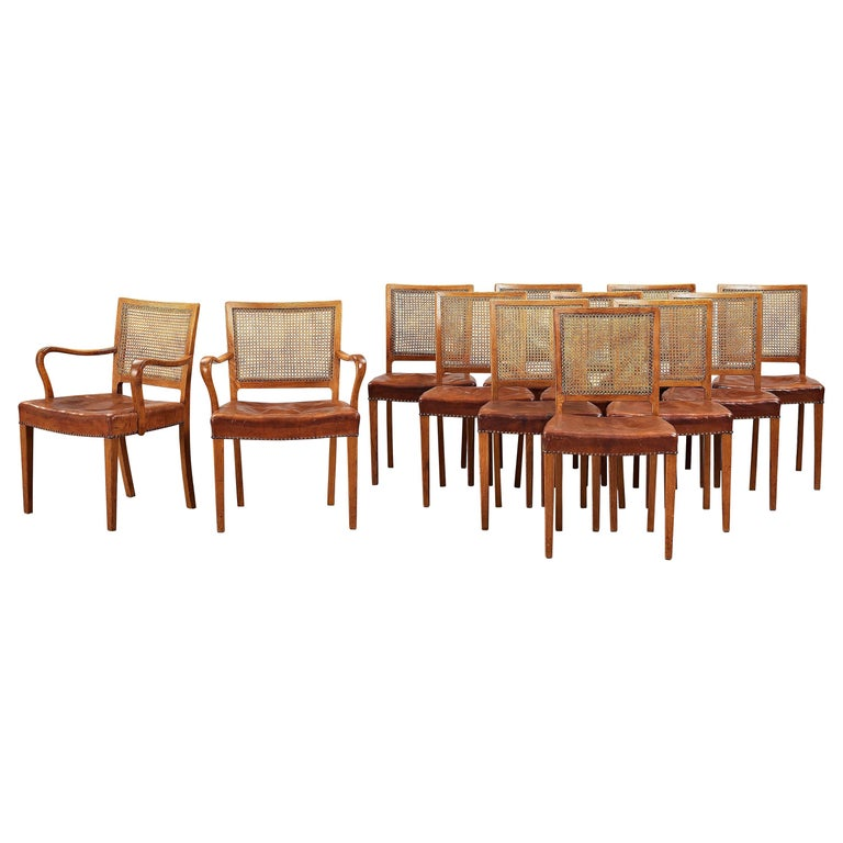 Erik Wørts Set of 12 Dining Chairs in Oak, Cane and Niger Leather, 1945 For Sale