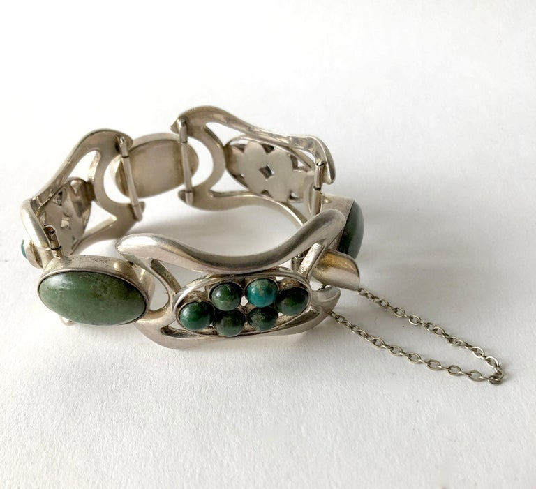 Mexican modernist sterling silver bracelet with Mexican jade cabochons created by Erika Hult de Corral of Puerto Vallarta, Mexico. Bracelet measures 1.25