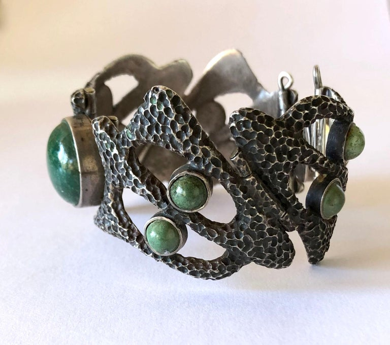Heavily textured sterling silver and with natural gemstones bracelet created by Erika Hult de Corral of Puerto Vallarta, Mexico. Bracelet has a wearable wrist measurement of 6.5