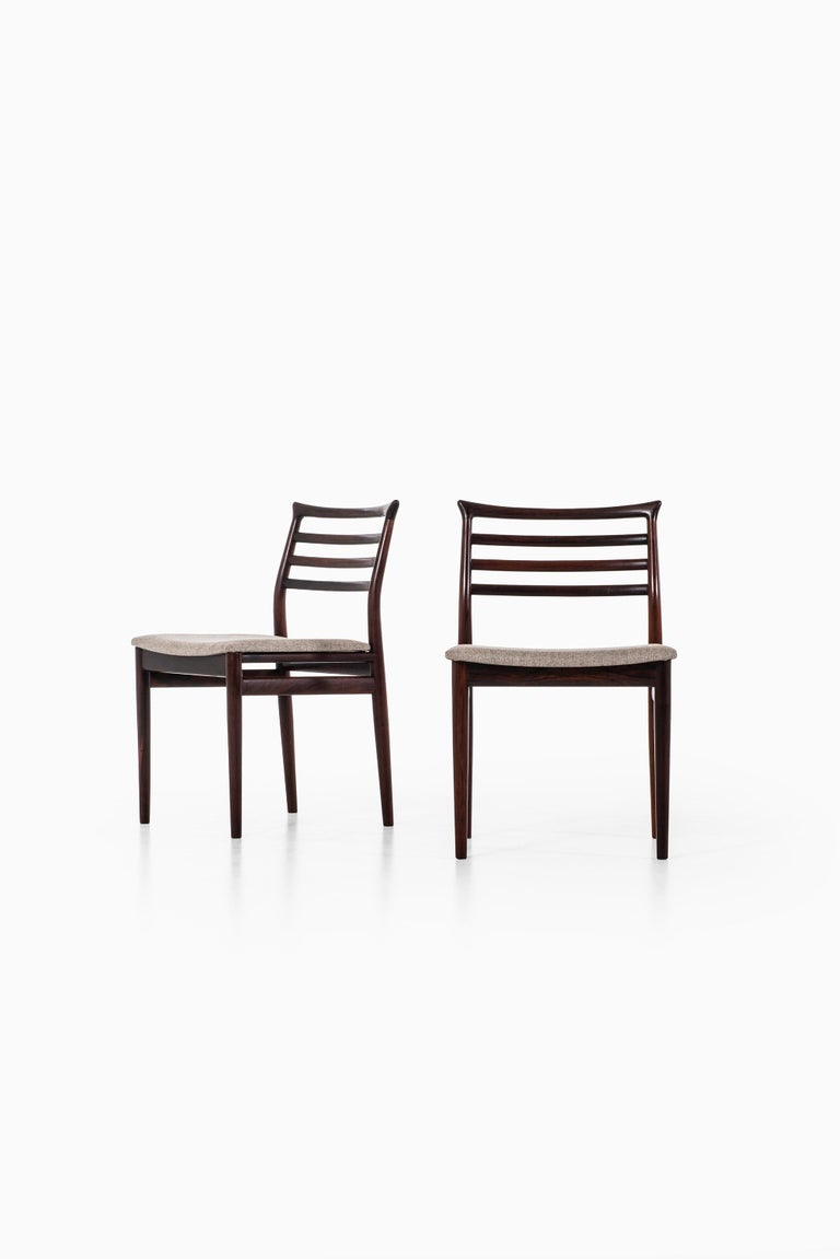 Rare set of 8 dining chairs designed by Erling Torvits. Produced by Sorø stolefabrik in Denmark.