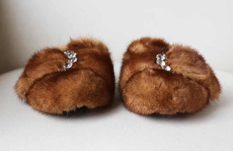 These Ermanno Scervino slippers have been made in Italy with soft mink-fur and embellsihed with an oversize buckle which is embellished with an array of large crystals.  Heel measures approximately 20 mm/ 0.8 inches. Brown fur (Mink). Slips on. Does