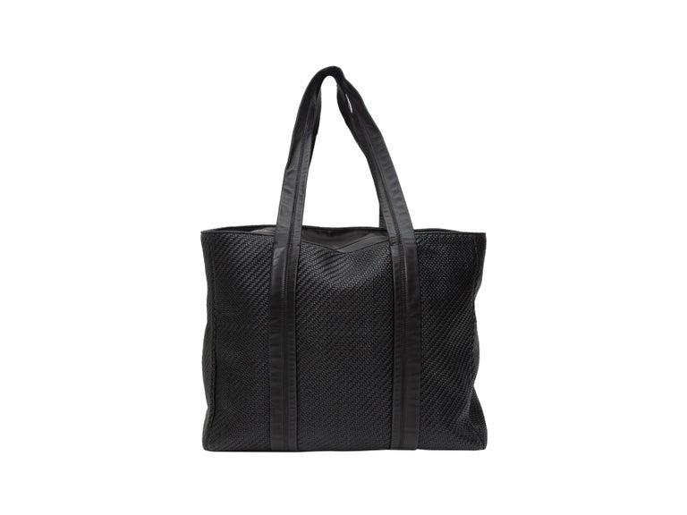 Product details: Black woven leather tote bag by Ermenegildo Zegna. Dual flat top handles. Zip closure at top. 18