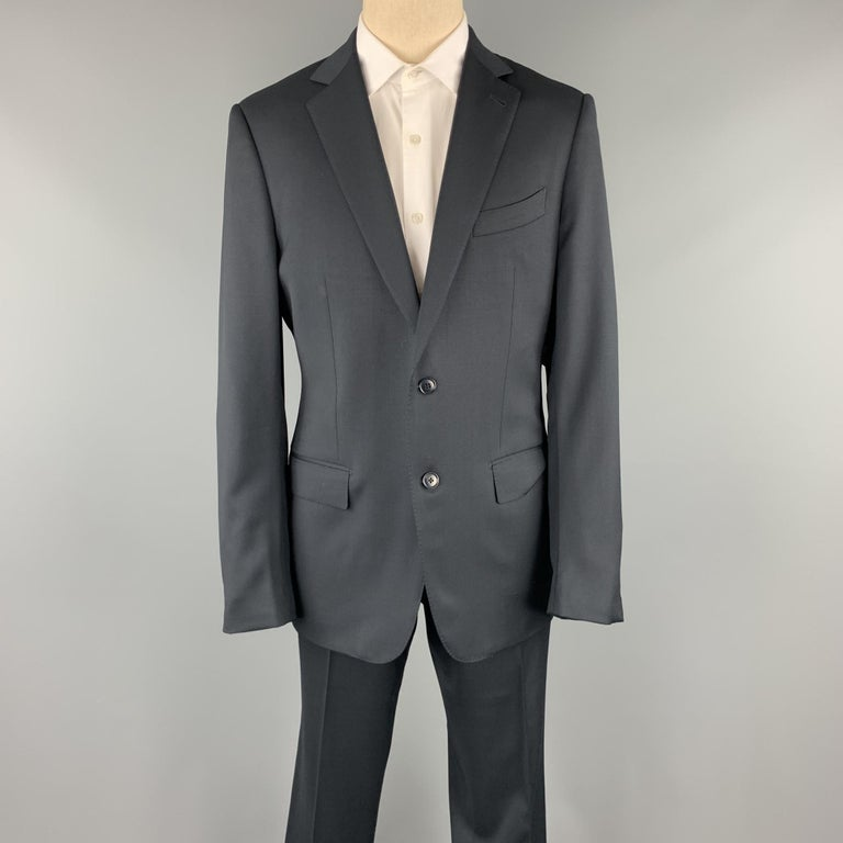 ERMENEGILDO ZEGNA suit comes in a black wool with a full liner and includes a single breasted, two button sport coat with a notch lapel and matching pleated front trousers.   Excellent Pre-Owned Condition. Marked: 52 R Original Retail Price: