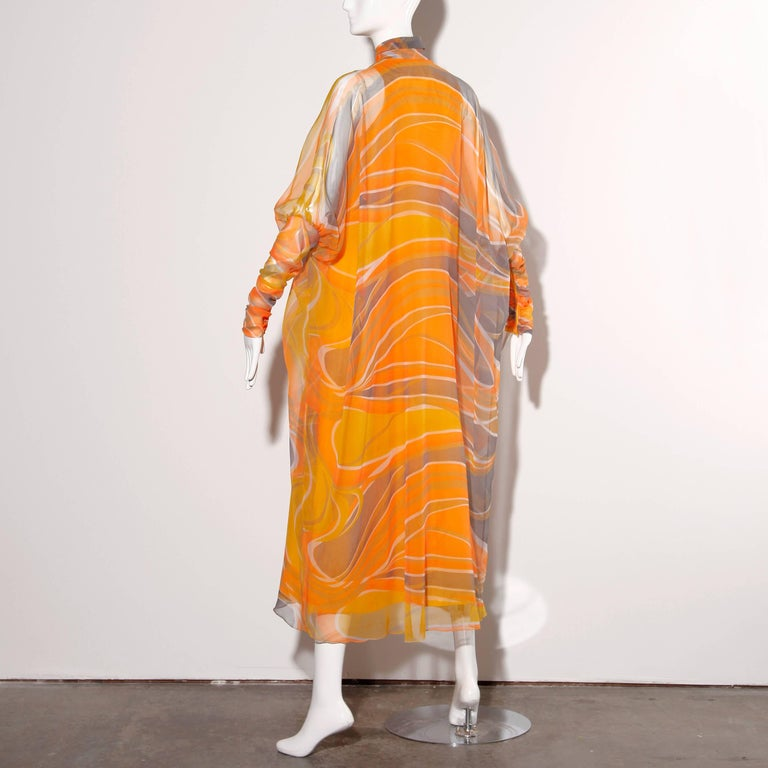 Amazing vintage caftan with giant batwing sleeves by Erna of Beverly Hills. Ruched zip sleeves and front covered button closure. The ultimate lounge caftan!  Details:  Partially Lined No Pockets Closure: Button Front/ Zipper Sleeves No Marked