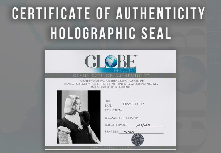 This black and white portrait features American actress, dancer, and singer Ginger Rogers, widely known for performing in films and RKO's musical films, partnered with Fred Astaire. She appeared on stage, as well as on radio and television,