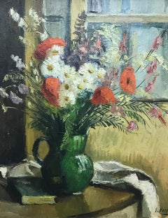 Vase and green book