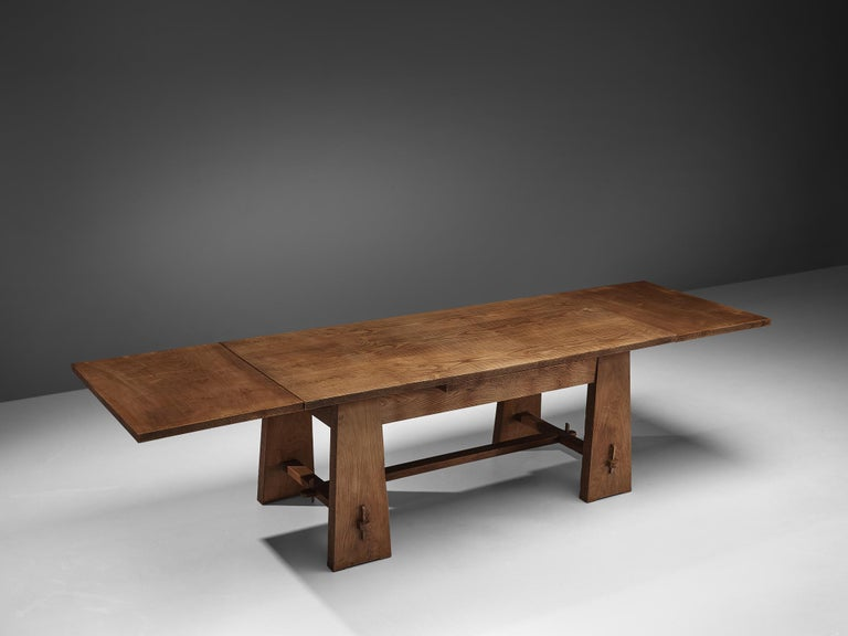 Ernesto Valabrega, dining table, oak veneer, wood, Italy, ca. 1935  This extendable dining table features two leaves that are 'hidden' under the tabletop. The leaves can be used to extend the table on one or both sides. Four flat legs are tapered