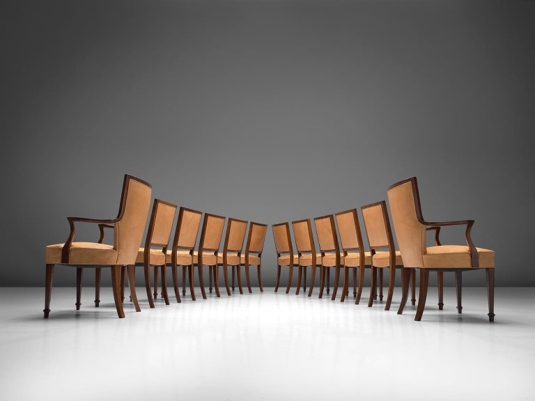 Ernst Kühn for Lysberg Hansen & Therp (attributed), set of twelve chairs in solid rosewood and leather, Denmark, 1935-1940.  This luxurious dining room set of early Danish chairs is most likely designed by the cabinetmaker Ernst Kühn for Lysberg