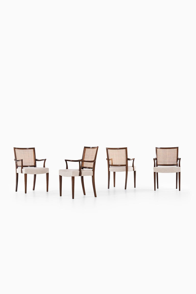 Rare set of 4 armchairs and 6 dining chairs designed by Ernst Kühn. Produced by Lysberg Hansen & Therp in Denmark.