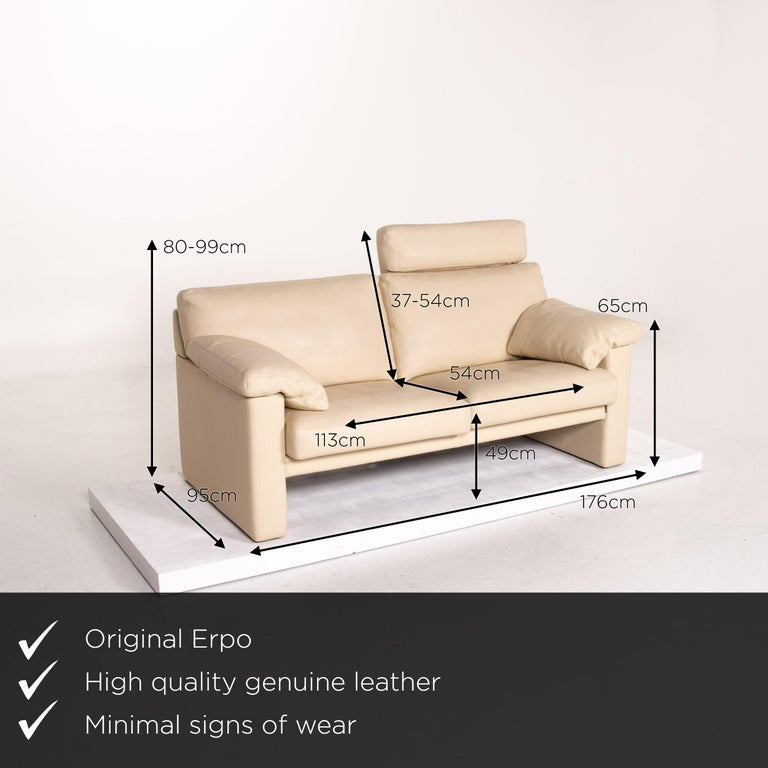 We present to you an Erpo leather sofa cream two-seat function couch.      Product measurements in centimeters:    Depth 95 Width 176 Height 99 Seat height 49 Rest height 65 Seat depth 54 Seat width 113 Back height 37.