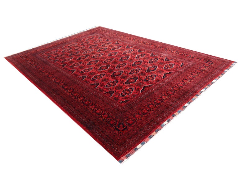 Large sized tribal rug Afghan Ersari Turkoman or Turkmen rug, circa 9 x 12 ft. decorative tribal art.  The Turkmen or Turkoman people are settling in villages in Afghanistan and Turkmenistan near the Persian border. Their origin is tribal nomadic,