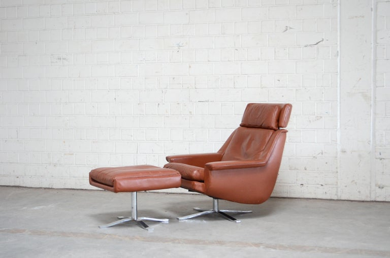 ESA Moebelwerk Denmark Model 802 lounge chair and ottoman. The design is from Werner Langenfeld during the 1960s This armchair and ottoman was produced in Denmark and is made of red brandy aniline leather. Rare model with a rare unique heavy