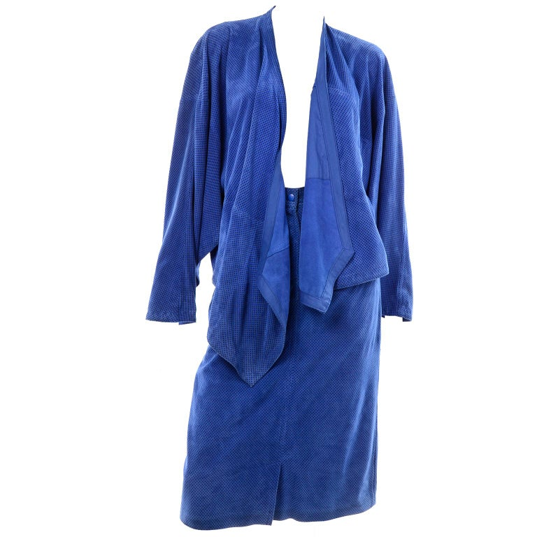 This is a stunning two piece ensemble designed by Margaretha Ley for Escada in the 1980's. The suit is made of blue suede with small black polka dots and includes a skirt and an open front wrap jacket w/ pockets. The original owner wore the outfit
