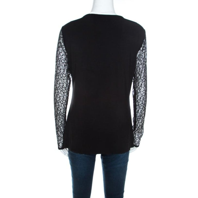 This black piece from Escada entwines femininity and style into one. It has an overlay of lace, sheer long sleeves and crystal embellishments on the scoop neckline. Be it with skirts or pants, this top will blend well.  Includes: The Luxury Closet