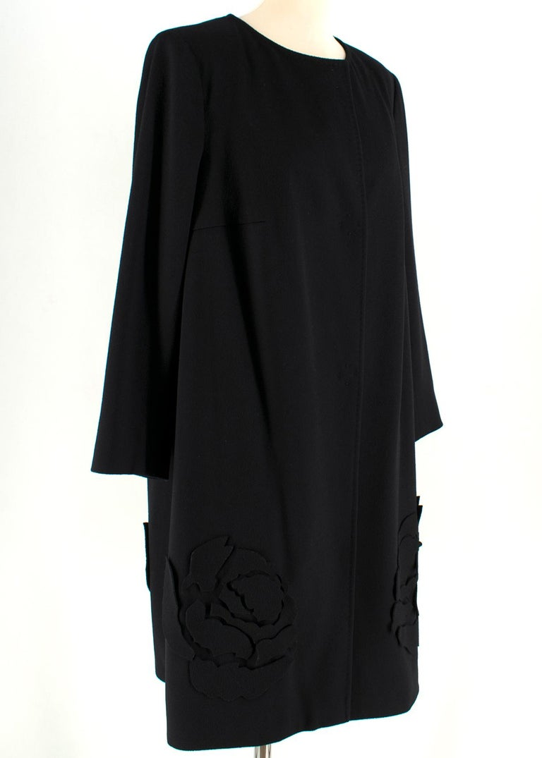 Escada Black Wool Blend Long Coat with Floral Embroidery  -Black, wool blend -Floral embroidery on trim -Light shoulder padding -Concealed three-button closure  -Unlined   Please note, these items are pre-owned and may show some signs of storage,