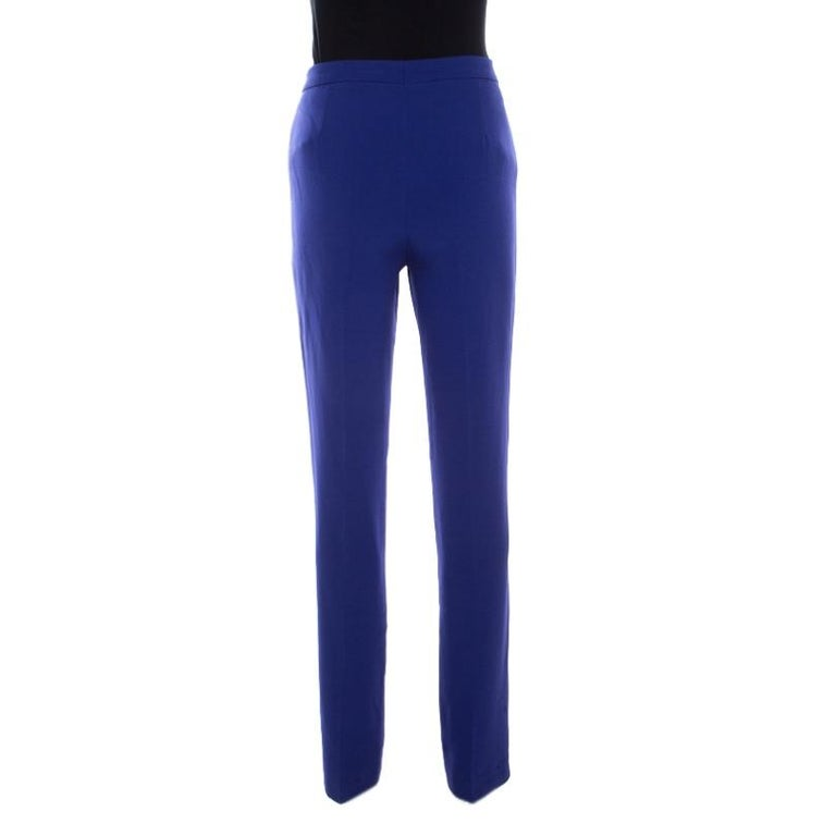 For a crisp look, pick these blue Tovah trousers from Escada. The contemporary high waist falls with neatly tailored legs offering a comfortable fit. Equipped with zip fastening, it can be worn on both casual and formal occasions.  Includes: The