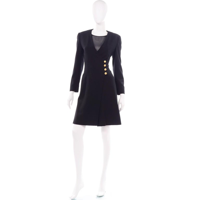 We love everything designed by Margaretha Ley for Escada, but we especially love this vintage Escada Couture romper! This rare black wool suit style romper is the perfect day dress alternative. Sheer black built in top is under a faux wrap style