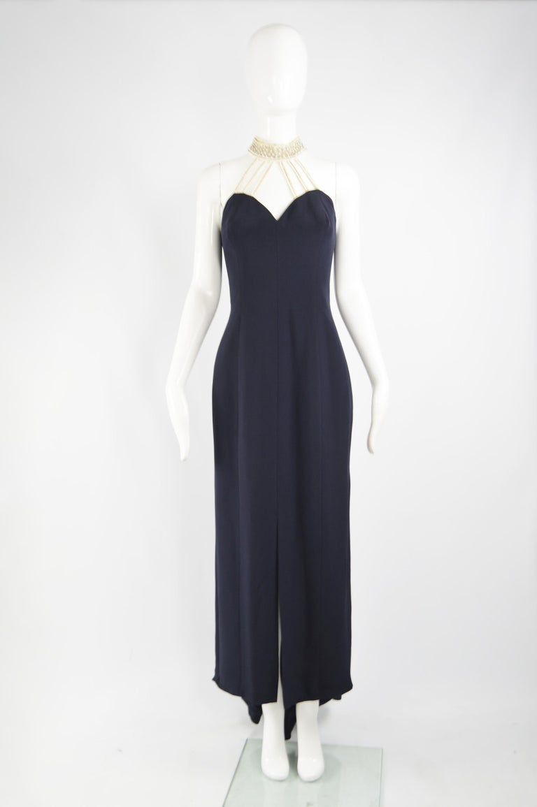 A fabulous vintage Escada evening gown from the 90s for their high end Couture line. In a blue silk and polyester with faux pearl beads creating a choker style neckline. Perfect for a formal party or red carpet event.   Size: Marked EU 40 which