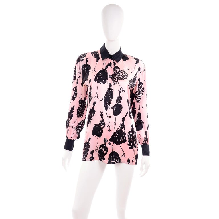 it's hard to find any better vintage blouses than those designed by Margaretha Ley for Escada!  We love the prints and the colors and of course, the quality.  This pink silk blouse has black cuffs and a black collar and the print is made of black
