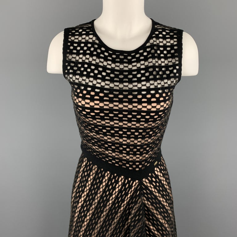 ESCADA sleeveless dress comes in black and grey stretch mesh with a round neckline, and flared skirt. Made in Italy.  Excellent Pre-Owned Condition. Marked: S  Measurements:  Shoulder: 14 in. Bust: 34 n. Waist: 26 in. Hip: 42 in. Length: 44 in.