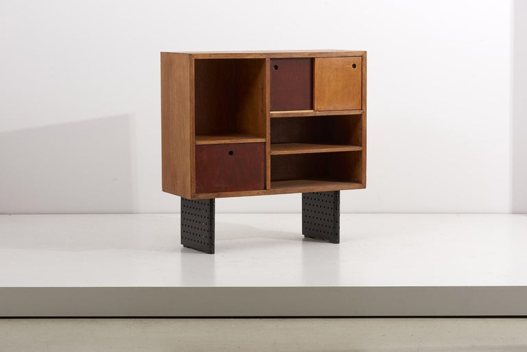 Very rare Escande cabinet, designed for University D' Antony. Escande was a student of Jean Prouvé and this piece shows an enormous resemblance to some of Prouve's best pieces. Oak frame with sliding doors and inset cubby shelf. The cabinet was