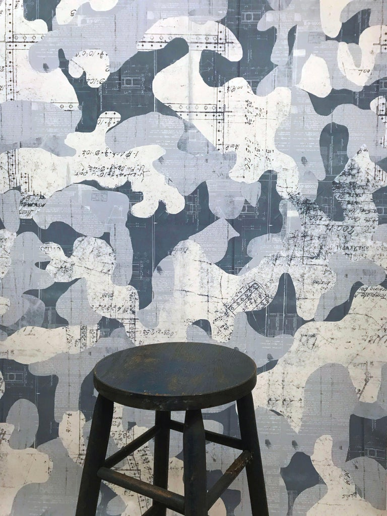 Escape was created using found vintage blue prints from the early to mid 1900s and placed into a fluid, hand drawn camouflage pattern. Intrigued by the idea that blue prints and camo have a utilitarian purpose, we combined them creating an opposite