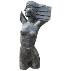 Escultura de busto de mujer tallada en marmol negro años 1970